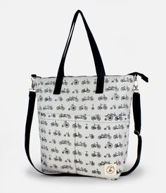 This grey bike printed reversible bag is made by Lady Alamo here in San Francisco. Use it as a tote or messenger bag, it can fit your laptop and has two interior and exterior pockets for keys, phones, and other small items. The entire piece is made with 100% cotton, and can be switched from solid to prints depending on your mood each day!