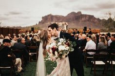 Have the couple kiss at the end of their ceremony on this end of the isle. Beautiful background!