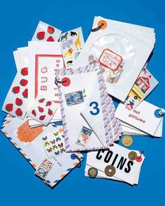 Kids can decorate a variety of envelopes, such as those used for CDs and airmail, with rubber stamps, vinyl lettering, or labels to keep coins, stamps, and other small collections in order.  Stack envelopes of the same size, and punch a hole in each (for thin paper, reinforce the corner with a plain round sticker before punching). Insert a keychain or loose-leaf ring into the hole, and add more envelopes as needed.