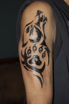 Beautiful Tribal Wolf Head With Paw Print Tattoo On Half Sleeve