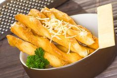 Crunchy on the outside and soft on the inside, these twisty breadsticks are equally suited to being dipped into a bowl of tomato basil or eaten by themselves. Parmesan Breadsticks Recipe, Tapas, Baking Flour, Tomato Basil, Wine Recipes, Wines, Carrots, Stuffed Peppers, Cheese
