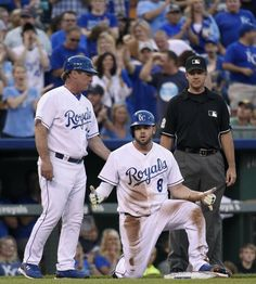 Kansas City Royals' Mike Moustakas (8) celebrates his triple in the third inning during Friday's baseball game against the New York Yankees on May 15, 2015 at Kauffman Stadium in Kansas City, Mo.