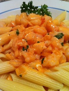 Shrimp pasta with tomato cream sauce. Shrimp, pasta, cream, tomato sauce, onions, garlic, basil, parsley, white wine