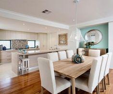 Offene Küche mit Bodenfliesen und Esszimmer mit Laminat - eine sichtbare Abtrennung