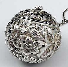 "Repousse antique sterling tea ball with gilded interior A finely chased sterling tea ball marked sterling only. Hand chased floral decoration and the original gilded interior.  Diameter: 1 3/8"".  Weight: 1 troy ounce.  Price: $395.00"