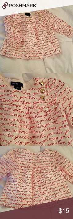 """Baby GAP Valentines Day top❤ ❤ Baby GAP long sleeve blouse features hearts and """"love you"""" all over.  ❤ Gold heart buttons on front!!! ❤Perfect 1st Valentines Day top for the fashion forward princess!  🌟EUC, like new!! GAP Shirts & Tops Blouses"""