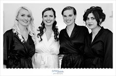 Bride and her Bridesmaids in robes before wedding