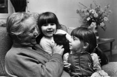 James Alfred 'Alf' Wight, OBE, FRCVS (1916 - 1995), known by the pen-name James Herriot, with granddaughters Zoe and Katrina