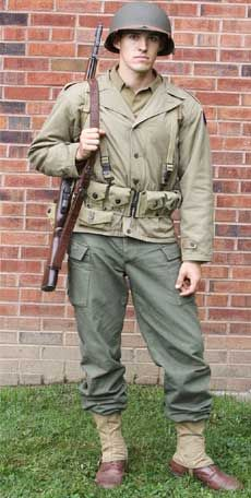 The basic WW2 US Infantryman uniform. He wears the M41 jacket and HBT trousers over his M1937 wool trousers. Photo courtesy of 'At the Front Militaria'