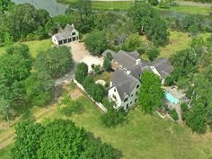 Extraordinary waterfront estate with 13 treed acres along Dickinson & Benson Bayous. The stucco structure [5915 sq. ft.] built in the early 1930's has extensive hardwoods, exotic stones, and wonderful imported pieces. Each room has fabulous views.