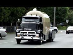Amazing cab over engine RV.. Leaving the annual Fathers Day show and shine in downtown Qualicum Beach. All aluminum camper. June 19th 2011.