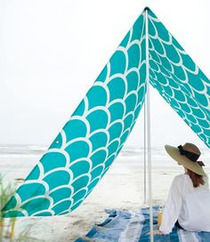 Stay sun safe with pretty beach shades and umbrellas at terrain.