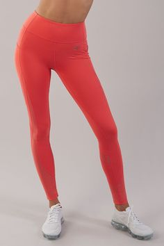 Bright workout style. The Sleek Sculpture Leggings 2.0 are a true one of a kind, now available in Intense Coral.