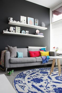 Black wall living room and pops of colour, noridc style in The Netherlands.