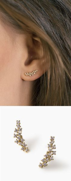 A cluster of crystals shines brilliantly in these modern crawlers, handcrafted with 14k gold.