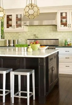 Love the black and white cabinetry. Bright green glass tile backsplash!