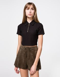 From Stelen, a cropped top with allover ribbing in black. Features pointed collar, half zipper with pull tab, short sleeves, cropped length, straight hem and stretch fit.   •Cropped top with allover ribbing in black •Pointed collar •Half zipper wit