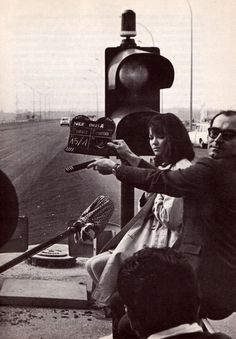 """Dir. Jean-Luc Godard with Anna Karina on the set of Made in U.S.A. (1966)"""