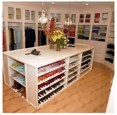 I love the idea of having a big closet..get book cases to make an island for my shoes like this