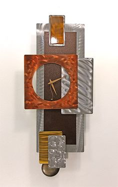 Sculpted Metal Pendulum Wall Clock Modern by statements2000, $295.00