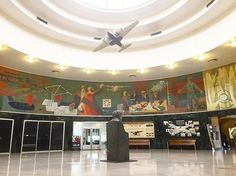 """James Brooks, """"Flight"""" (1942) Depicting man's quest to conquer the skies, this last and largest mural produced under the auspices of the WPA was painted over by Port Authority bureaucrats -- upset by its social realist style and strong depiction of workers -- in 1952 at the height of McCarthy anti-communist fervor. It wouldn't see the light of day again until 1980, when amateur aviation historian Geoffrey Arend raised the funds to uncover it. #ohny #openhousenewyork #wpa #murals"""