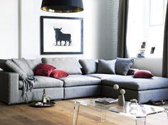 grey sofa + black light + lucite table + white brick