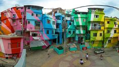 A painting project has brought art to the Santa Marta favela in Rio de Janeiro. (Great article on city design from NY Times. Santa Marta, Ral Paint, Relaxing Bathroom, Slums, Perfect World, Home And Deco, World Of Color, Community Art, Architecture Design