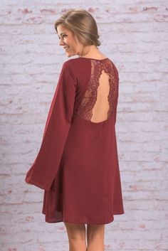 Loving this dress forever will be one of the easiest things you've ever done! It's gorgeous burgundy color is perfect for holiday parties and fall in general! The back is the real stunner though! The open can is lined with some mesmerizing sheer lace!  Material has no amount of stretch. Miranda is wearing the small.