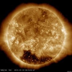 """A dark hole hundreds of times bigger than the Earth has been spotted on the surface of the sun. A photo of the enormous """"coronal hole"""" (below) was snapped by a camera aboard NASA's Solar Dynamics Observatory on Jan. 1, 2015."""