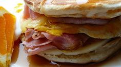 Ham, cheese, and a fried egg are sandwiched between two buttermilk pancakes and covered with syrup. A great way to use up leftover pancakes!