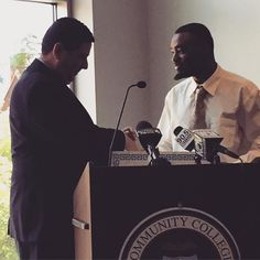 Mayor @billpeduto shakes hands with CCAC Learn & Earn intern Anunnaqi Withrow-Davis.