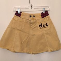 Dolce & Gabbana sporty skirt This skirt is worn. The elastic in the waist is slightly worn out but it snaps closed anywayZ Felt logo on front pocket. Pilling on the waistband Dolce & Gabbana Skirts Mini
