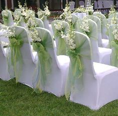 Chair covers with flowers - I like the idea of putting something interesting in the back sash part.