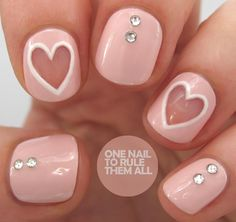 We're in love with the negative-space nail art trend right now, and One Nail To Rule Them All is making us envious with this heart design. Between the soft pink, white hearts, and Swarovski crystals, this makes for one seriously sweet Valentine's mani. Check out the step-by-step guide for full instructions.