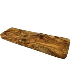 Olive Wood Thin Rectangular Tray -- Striking! Our Olive Wood Thin Rectangular Tray is perfect for serving cheese, bread, fish or any other small dish or appetizer. Handcrafted from older olive trees that no longer produce olives, each piece is unique and sustainable. Every time a tree is cut down, another is planted in its place. The rich color and grain will darken over time, becoming even more beautiful.