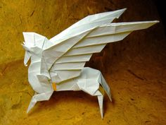 This is pegasus by Mr. One of my favourite origami masterpiece. It reminds me of that buff pegasus from Disney's Hercules Not exactly . Pegasus by Fumiaki Kawahata Origami Dragon, Origami Paper, Mythological Animals, Paper Art, Paper Crafts, Origami Animals, Origami Tutorial, Paper Folding, Creative Art