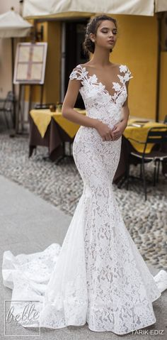 cf4ae6a6c7a4 Lace mermaid wedding dress with off the shoulders illusion neckline with  long train and cap sleeves See more gorgeous wedding dresses by ...