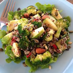 'Quinoa & Greens salad' This baby is super quick and easy as I had left over cooked quinoa in the fridge. In a pan over medium heat sauté whatever greens you have on hand.. I used zucchini + broccoli...