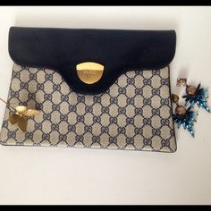 Oversized Gucci Signature Clutch Great vintage condition! A small smudge on the  back. The lock isn't closing and hardware may need to be replaced. Scratches & fading on the logo plate. Gucci Bags Clutches & Wristlets