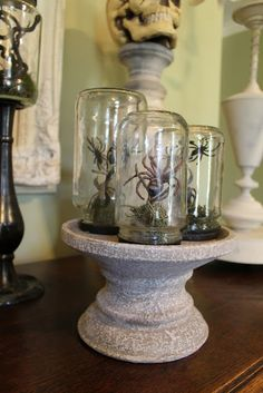 This could easily be recreated with the coranado stone pedestal and the thimble domes at www.designwithmadeline.willowhouse.com