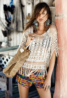 Crochet fringe top £14 (March) Printed shorts £4 (May) feather earrings £5 (March) Straw tote £7 (April)