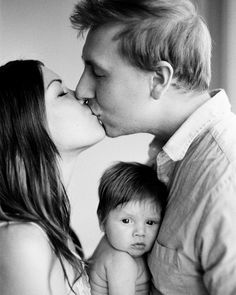Kids in the middle with parents kissing