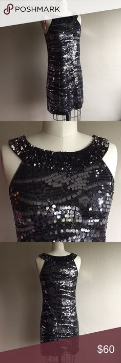 Rachel Zoe Embellished Party Dress Black Embellished dress by Rachel Zoe, size Petite (small). Pulls over head, no zipper needed. Flattering fit and in great condition, only worn once. Black and dark silver sequin embellishments. Perfect for New Years and upcoming holiday parties. Rachel Zoe Dresses Mini