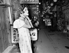 Even though there's no sign of any customers ... near Ikebukuro, Hikarimachi, Ohashi, by Seiji Kurata, 1975. Kurata's starkly lit images depict the seedy, often violent underbelly of gang culture in the notorious Ikebukuro and Shinjuku districts of Tokyo. Photograph: Seiji Kurata/Zen Foto Gallery, Japan