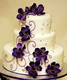 Love the color of the flowers against the white of the cake. Very dramatic!