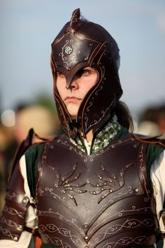 female leather armor, with leather cut decorative motifs (THIS is how you do female armor! In real battle, you want to protect soft spots, not advertise them)