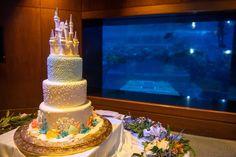 Becca & Hunter has the perfect cake to match their venue of The Living Seas Salon! Click link in bio to see more! ⠀ ⠀ ⠀ 👰: @handbshappilyeverafter⠀ 📸: @ali.nasser.photo @caldwellphotographicstudio⠀ ⠀ ⠀ ⠀ #disneyweddingpodcast #fairytaleweddingsguide #disneywedding #weddingcake #hiddenmickey #weddingcakes #weddingcakeideas #weddingcakedesign #weddingcaketopper #cakesofinstagram #weddingcakeinspo #weddingcakewednesday #disneyweddingcake #weddingwednesday #cakestagram… Wedding Cake Decorations, Wedding Cake Designs, Wedding Cake Toppers, Wedding Cake Prices, Wedding Cakes, Mad Hatter Wedding, Blackberry Cake, Becca, Seas