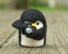 This super tiny and cute penguin miniature is ideal for doll-houses and private collections as it is really small and very cute and beautiful.  This cute penguin is made of delightfully soft, and warm to the touch felting wool.  It is made from non-smoking environment.  Finished size: 4.5cm (1.5in)  If this toy isnt your style, but you still want a cuddly animal, check out our other animals: https://www.etsy.com/shop/EMEREN Were sure to have the right friend for you!    Thank you for…