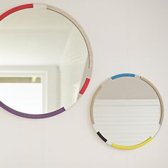 Bound round mirrors from Grain $750. could make this by painting patches of color around a wooden frame.