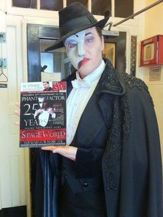 John Owen-Jones (2011 London cast) holding Stage World Mag with him as cover